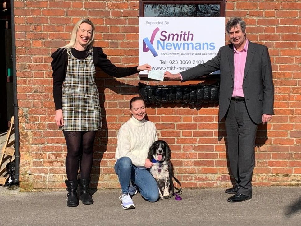 Smith Newmans hands over cheque to Pensions 4 Paws
